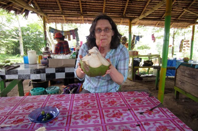 enjoying fresh coconut