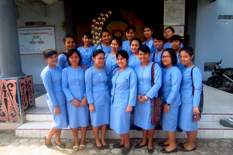 Posing for a group photo after worship.