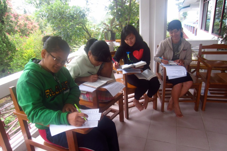 2nd year students in Bible study at a retreat.