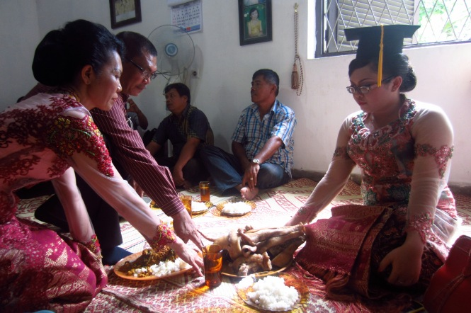 Batak family culture. The parents say a blessing prayer.