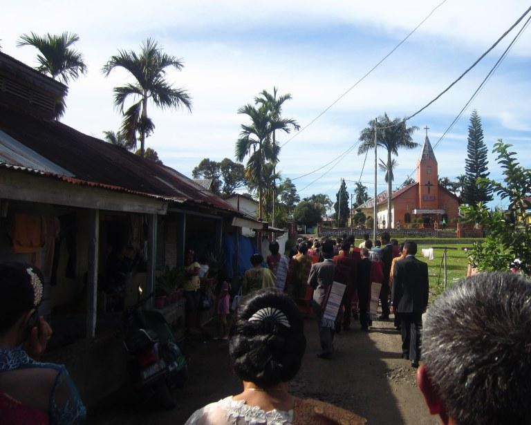 Wedding procession to the church. Sidamanik village, 23 August 2012.