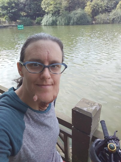 I rode my by to the small man-made lake near my apartment.