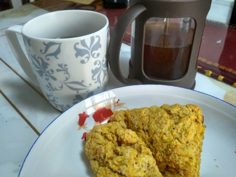Homemade pumpkin scones from scratch and fresh brewed coffee.