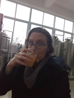 Tasting the freshly brewed beer from the Biology department.