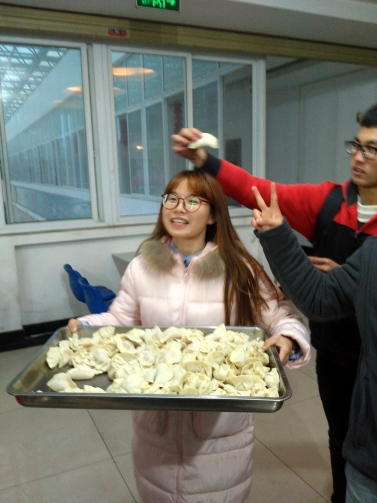 Making dumplings with students.