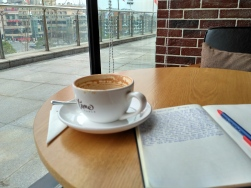 Enjoying a coffee at a coffee shop in a new nearby mall.
