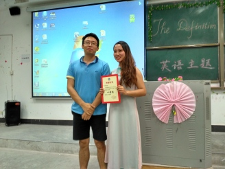 My student with her certificate for the speech competition