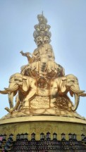 Golden statue at the summit of Mt. Emei.
